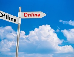 """Two way road pointer with """"online"""" and """"offline"""" directions against cloudscape"""